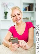 Купить «girl texting on mobile phone indoors», фото № 23526636, снято 20 марта 2019 г. (c) Яков Филимонов / Фотобанк Лори