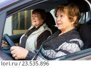 Купить «women driving in European city», фото № 23535896, снято 21 декабря 2015 г. (c) Яков Филимонов / Фотобанк Лори