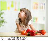 kid girl with expression of disgust against vegetables. Стоковое фото, фотограф Оксана Кузьмина / Фотобанк Лори