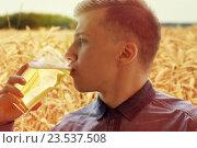 Купить «close up of young man drinking beer from glass», фото № 23537508, снято 22 июля 2016 г. (c) Syda Productions / Фотобанк Лори