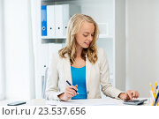 Купить «businesswoman with calculator counting at office», фото № 23537656, снято 31 июля 2016 г. (c) Syda Productions / Фотобанк Лори