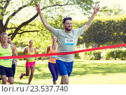 Купить «happy young male runner winning on race finish», фото № 23537740, снято 16 августа 2015 г. (c) Syda Productions / Фотобанк Лори