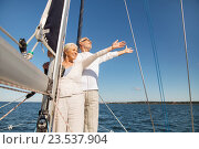 Купить «senior couple hugging on sail boat or yacht in sea», фото № 23537904, снято 18 августа 2015 г. (c) Syda Productions / Фотобанк Лори