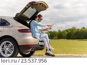 Купить «happy man and woman with road map at hatchback car», фото № 23537956, снято 12 июня 2016 г. (c) Syda Productions / Фотобанк Лори