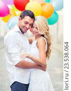 Купить «couple with colorful balloons», фото № 23538064, снято 14 июля 2013 г. (c) Syda Productions / Фотобанк Лори