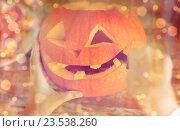 Купить «close up of woman with pumpkins at home», фото № 23538260, снято 17 сентября 2014 г. (c) Syda Productions / Фотобанк Лори