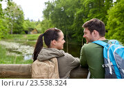 smiling couple with backpacks in nature. Стоковое фото, фотограф Syda Productions / Фотобанк Лори