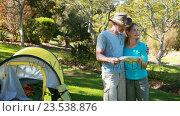 Купить «Hiker couple looking at map», видеоролик № 23538876, снято 17 июля 2019 г. (c) Wavebreak Media / Фотобанк Лори