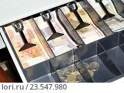 Купить «Деньги в кассе», эксклюзивное фото № 23547980, снято 18 сентября 2016 г. (c) Яна Королёва / Фотобанк Лори