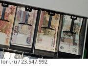 Купить «Деньги в кассовом аппарате», эксклюзивное фото № 23547992, снято 18 сентября 2016 г. (c) Яна Королёва / Фотобанк Лори