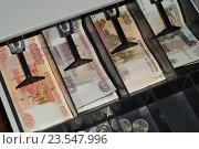 Купить «Деньги в кассовом аппарате», эксклюзивное фото № 23547996, снято 18 сентября 2016 г. (c) Яна Королёва / Фотобанк Лори