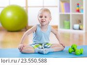 Купить «happy child little boy goes in for sports», фото № 23550588, снято 29 февраля 2016 г. (c) Оксана Кузьмина / Фотобанк Лори