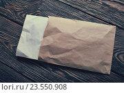 Открытый конверт на столе. Стоковое фото, фотограф ouh_desire / Фотобанк Лори