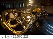 Купить «Тромбон - духовой медный оркестровый музыкальный инструмент лежит на рояле на сцене концертного зала», фото № 23560228, снято 20 сентября 2016 г. (c) Николай Винокуров / Фотобанк Лори
