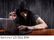Young hacker in digital security concept. Стоковое фото, фотограф Elnur / Фотобанк Лори