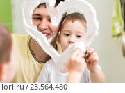 Купить «Father and son child draw heart shape on mirror with shaving foam playing in bathroom», фото № 23564480, снято 26 сентября 2015 г. (c) Оксана Кузьмина / Фотобанк Лори