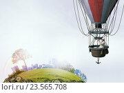 Купить «Man traveling in aerostat . Mixed media», фото № 23565708, снято 7 октября 2014 г. (c) Sergey Nivens / Фотобанк Лори
