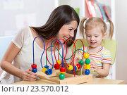 Купить «happy kid girl and mom playing toy», фото № 23570012, снято 2 февраля 2016 г. (c) Оксана Кузьмина / Фотобанк Лори