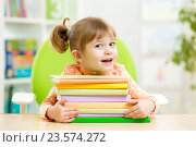 Купить «Smart kid girl preschooler with books», фото № 23574272, снято 31 октября 2014 г. (c) Оксана Кузьмина / Фотобанк Лори