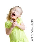 Купить «happy kid girl eating ice cream isolated», фото № 23574408, снято 10 марта 2015 г. (c) Оксана Кузьмина / Фотобанк Лори