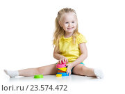Купить «child little girl playing with color toys», фото № 23574472, снято 10 марта 2015 г. (c) Оксана Кузьмина / Фотобанк Лори