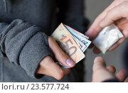 Купить «close up of addict buying dose from drug dealer», фото № 23577724, снято 9 июня 2016 г. (c) Syda Productions / Фотобанк Лори