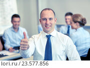 Купить «group of smiling businesspeople meeting in office», фото № 23577856, снято 25 октября 2014 г. (c) Syda Productions / Фотобанк Лори