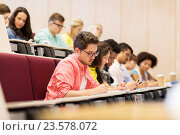 Купить «group of students with notebooks in lecture hall», фото № 23578072, снято 19 июня 2016 г. (c) Syda Productions / Фотобанк Лори