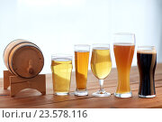 Купить «close up of different beers in glasses on table», фото № 23578116, снято 22 июля 2016 г. (c) Syda Productions / Фотобанк Лори