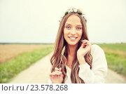 Купить «smiling young hippie woman on cereal field», фото № 23578268, снято 27 августа 2015 г. (c) Syda Productions / Фотобанк Лори