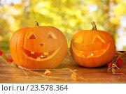 Купить «close up of pumpkins on wooden table outdoors», фото № 23578364, снято 17 сентября 2014 г. (c) Syda Productions / Фотобанк Лори