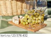 Купить «picnic basket with wine glasses, grapes and cheese», фото № 23578432, снято 18 августа 2015 г. (c) Syda Productions / Фотобанк Лори
