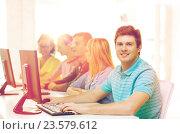 Купить «male student with classmates in computer class», фото № 23579612, снято 29 марта 2014 г. (c) Syda Productions / Фотобанк Лори
