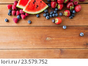 Купить «close up of fruits and berries on wooden table», фото № 23579752, снято 5 августа 2016 г. (c) Syda Productions / Фотобанк Лори