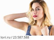 Купить «Portrait of beautiful woman posing against white background», фото № 23587588, снято 15 февраля 2016 г. (c) Wavebreak Media / Фотобанк Лори