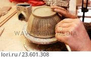 Купить «Close-up of potter carving pot», видеоролик № 23601308, снято 26 мая 2019 г. (c) Wavebreak Media / Фотобанк Лори