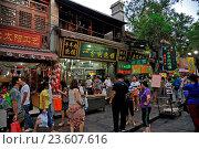 Купить «Asia, China, Xi'an City, People in street market.», фото № 23607616, снято 16 июля 2018 г. (c) age Fotostock / Фотобанк Лори