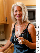 Купить «A 52 year old blond woman smiling at the camera dressed in a negligee in a kitchen.», фото № 23623124, снято 30 июля 2016 г. (c) age Fotostock / Фотобанк Лори