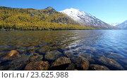 Купить «Stones on the bottom of Lower Multinskoe lake in Altai», видеоролик № 23625988, снято 24 сентября 2016 г. (c) Serg Zastavkin / Фотобанк Лори