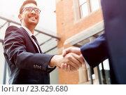 Купить «Two businessmen shaking their hands», фото № 23629680, снято 4 апреля 2015 г. (c) Sergey Nivens / Фотобанк Лори