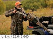 Купить «Hunter Getting Rifle From Atv», фото № 23643640, снято 18 февраля 2020 г. (c) age Fotostock / Фотобанк Лори