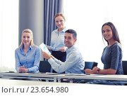 Купить «smiling business people with papers in office», фото № 23654980, снято 25 октября 2014 г. (c) Syda Productions / Фотобанк Лори