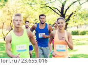 Купить «happ young sportsmen racing wit badge numbers», фото № 23655016, снято 16 августа 2015 г. (c) Syda Productions / Фотобанк Лори