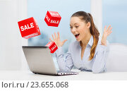 Купить «surprised businesswoman with laptop and sale signs», фото № 23655068, снято 8 декабря 2013 г. (c) Syda Productions / Фотобанк Лори