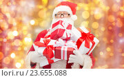 man in costume of santa claus with gift boxes. Стоковое фото, фотограф Syda Productions / Фотобанк Лори