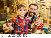 Купить «boy with dad holding chisel and hammer at workshop», фото № 23655152, снято 14 мая 2016 г. (c) Syda Productions / Фотобанк Лори