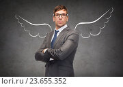 Купить «businessman with angel wings over gray», фото № 23655352, снято 17 ноября 2018 г. (c) Syda Productions / Фотобанк Лори