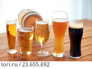 Купить «close up of different beers in glasses on table», фото № 23655692, снято 22 июля 2016 г. (c) Syda Productions / Фотобанк Лори