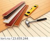 Купить «Laying hardwood parquet concept. Hammer and level on the floor.», фото № 23659244, снято 8 июля 2020 г. (c) Maksym Yemelyanov / Фотобанк Лори