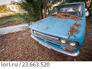 Купить «Old blue Datsun 1300 pickup car», фото № 23663520, снято 16 августа 2016 г. (c) EugeneSergeev / Фотобанк Лори